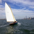 BESHERTE, a Buzzards Bay 18 built by Artisan Boatworks, Rockport, Maine, sails in New York with the backdrop of the Manhattan skyline